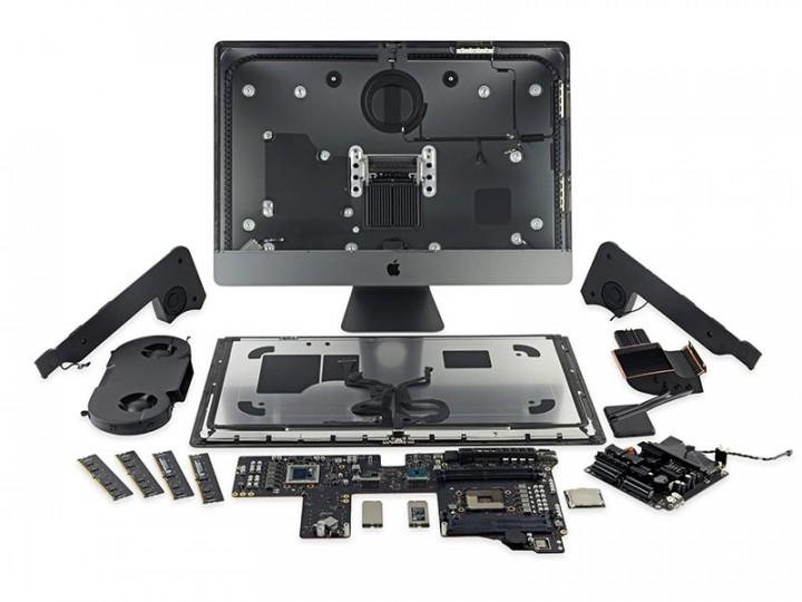 разобранный iMac занимает большой стол и еще немного